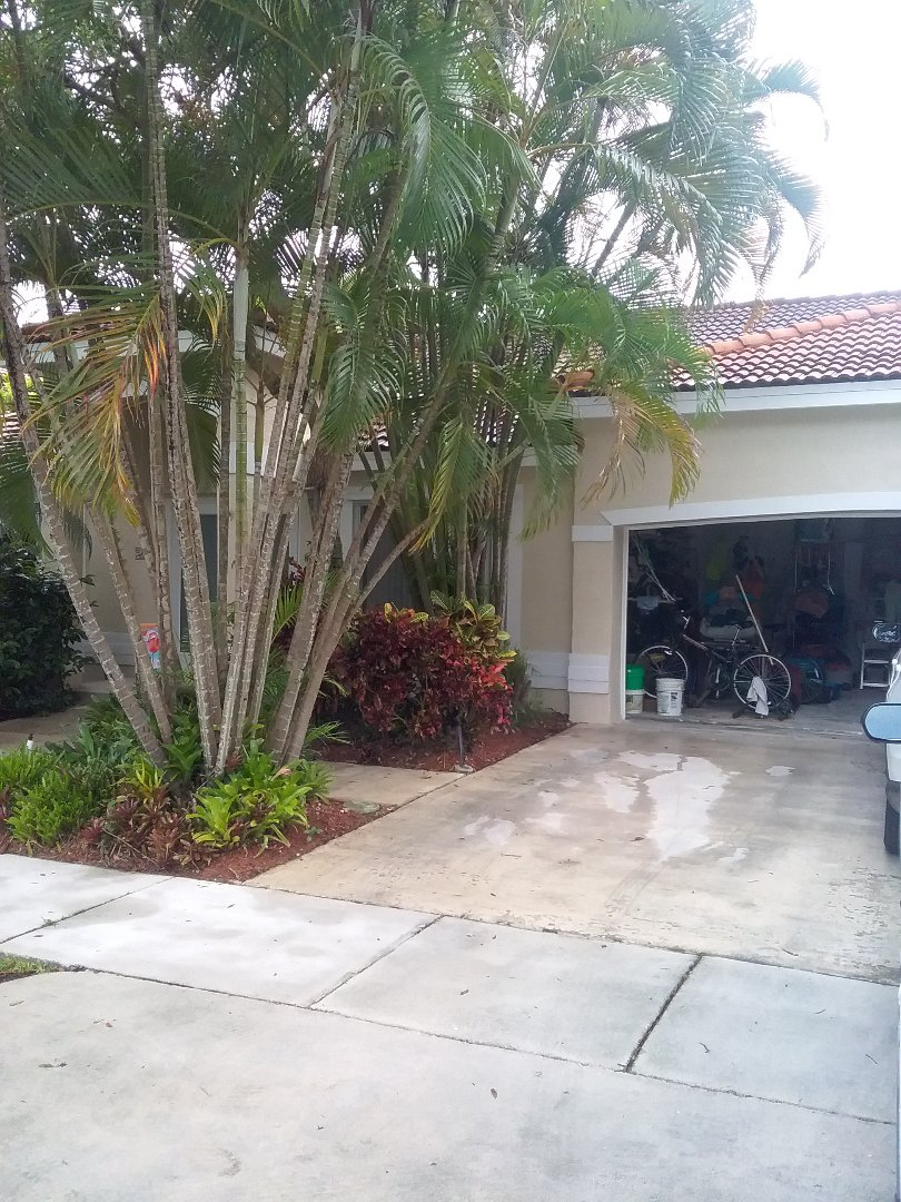 Hialeah, FL - Roof tile repair in the city of Miami Florida this repair is being done by Earl W Johnston roofing company Tony and Ron are you repair technicians
