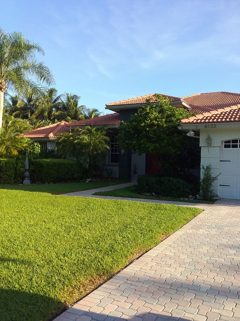 Davie, FL - Tile roof repair in the city of Davie Florida this repairs being done by Earl W Johnston roofing company Tony and Ron are you repair technicians