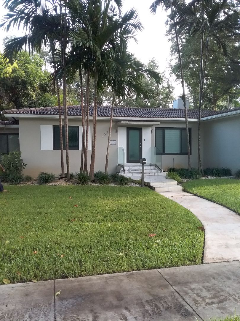 Miami Shores, FL - Tile roof repair in the city of Miami Shores Florida this repairs being done by Earl W Johnston roofing company Tony and Ron are you repair technicians