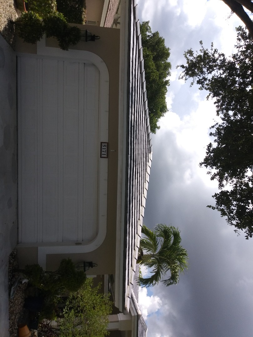 Pompano Beach, FL - Clean edges and Roofacide service guys Darron and Gary