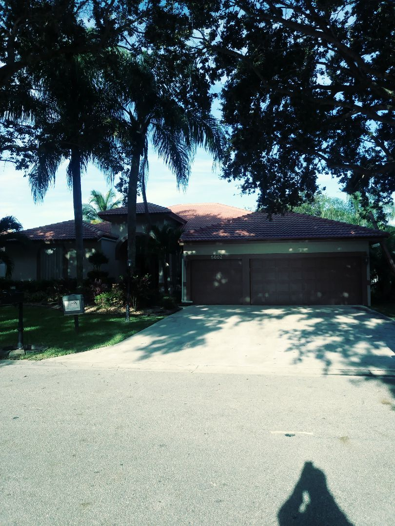 Coral Springs, FL - Finished eagle Malibu terracombra range concrete roof tile by earl w Johnston roofing llc