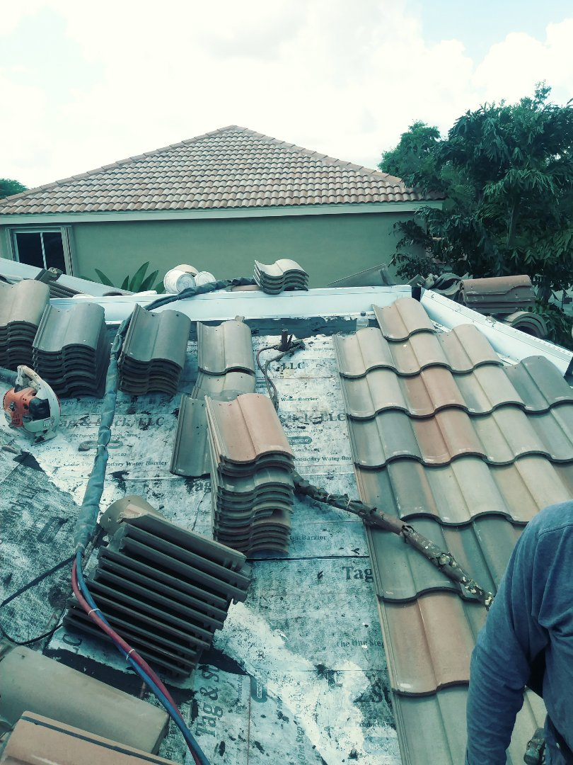 Weston, FL - Roof Tile being installed by earl w Johnston roofing llc