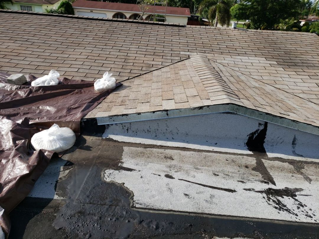 Miramar, FL - Shingle and flat roof leak repair estimate in Miramar, FL by Mike Wilde of Earl Johnston Roofing