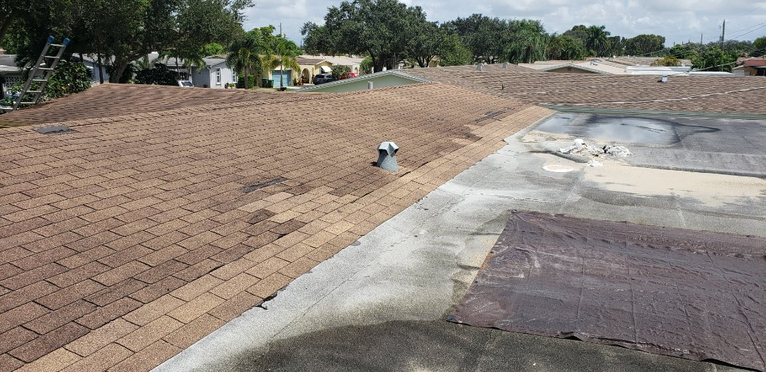 Shingle and flat roof repair estimate in Cooper City, FL by Mike Wilde of Earl Johnston Roofing