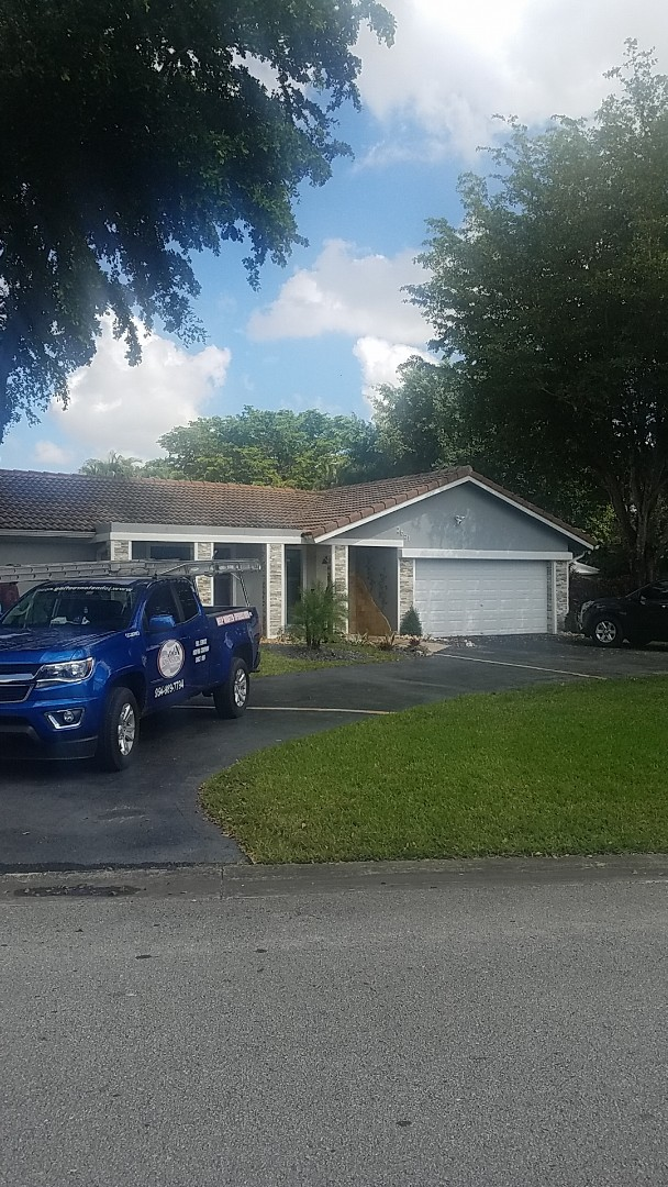 Coral Springs, FL - Tile roof repair estimate by Aj from Earl Johnston Roofing Company