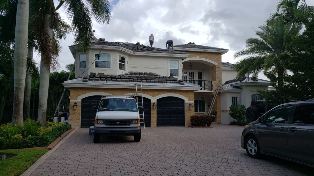 Cooper City, FL - Eagle Bel air tile is being installed by Mike Wilde of Earl Johnston Roofing in Davie, FL
