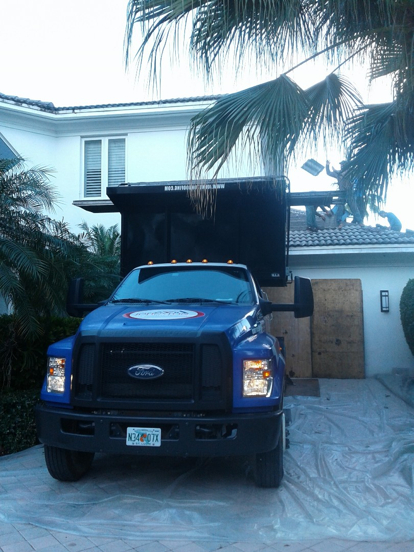 Aventura, FL - Starting a 38sq tile reroof in Aventura, by Earl w Johnston roofing