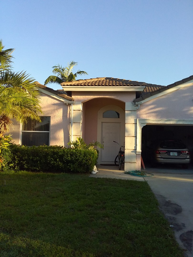 Cooper City, FL - Roof tile repair in the city of Cooper City Florida this repair is being done by Earl W Johnston roofing company Tony and Regis are you repair technicians