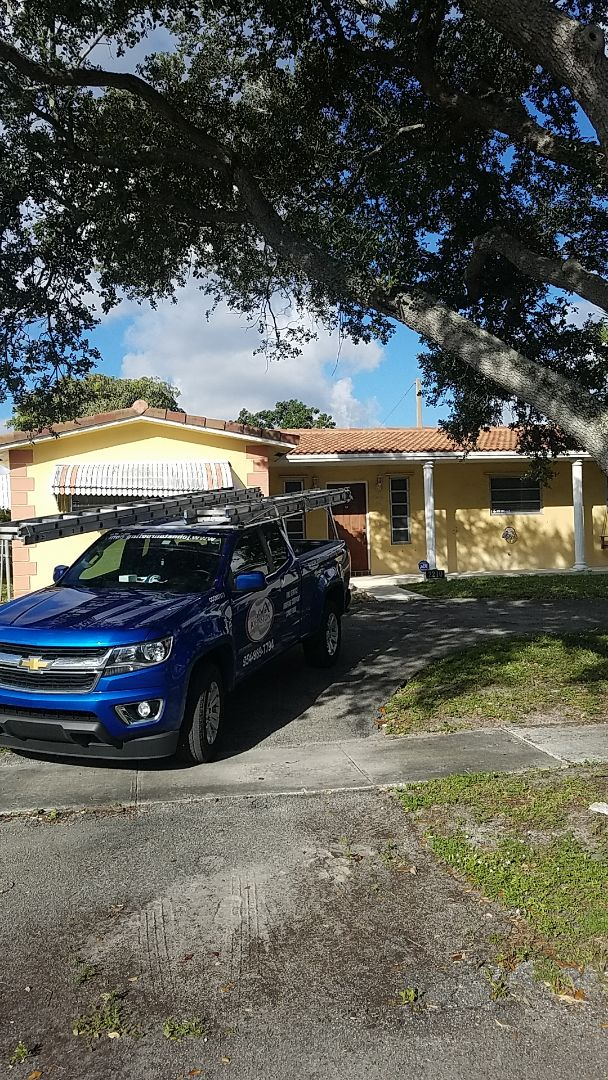 Hollywood, FL - Tile and flat roof leak repair estimate by Earl Johnston Roofing Company