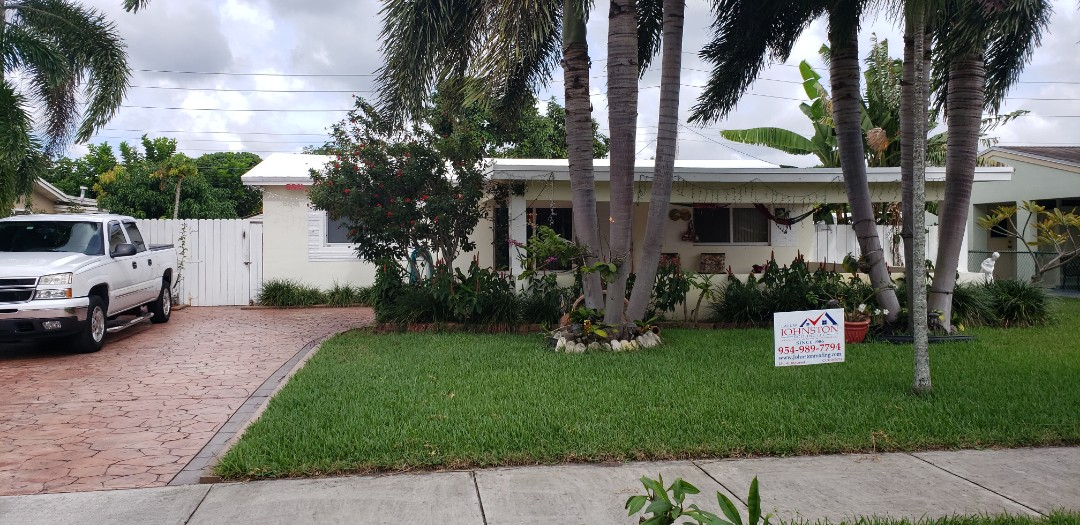 Hollywood, FL - Gaf Timberline hd shingle and Freedom TPO flat reroof is signed in Hollywood,FL by Mike Wilde of Earl Johnston Roofing