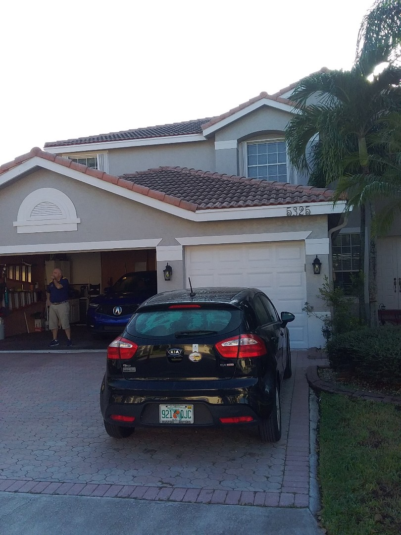 Tamarac, FL - Roof tile repair in the City of Coral Springs Florida this repair is being done buy Earl W Johnston roofing company Tony and Justin are you repair technicians