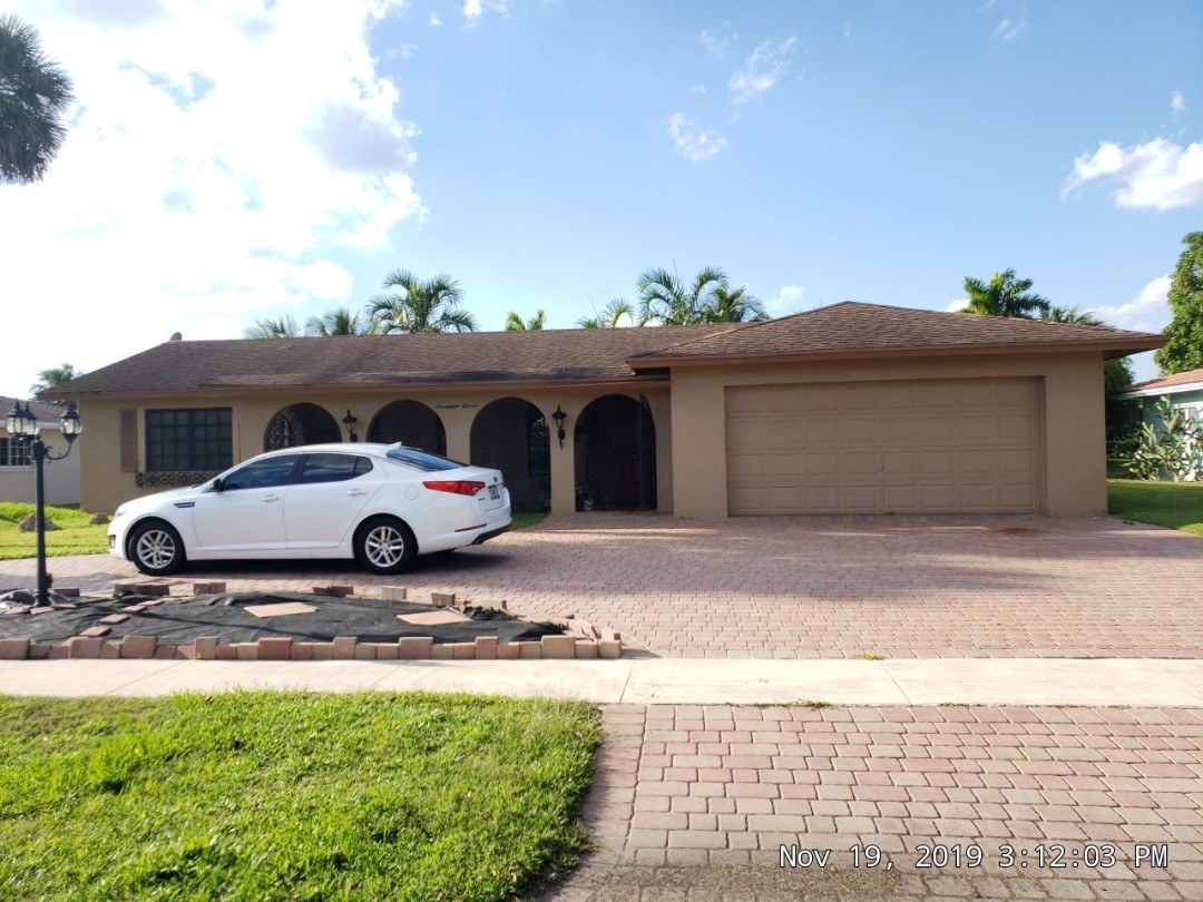 Gaf Timberline hd shingle and flat re-roof estimate in Plantation, FL by Mike Wilde of Earl Johnston Roofing