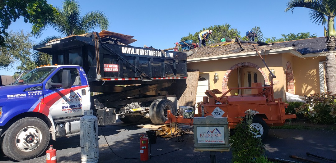Cooper City, FL - Gaf Timberline hd shingle and flat re-roof is starting today in Cooper City Florida by Mike Wilde of Earl Johnston Roofing