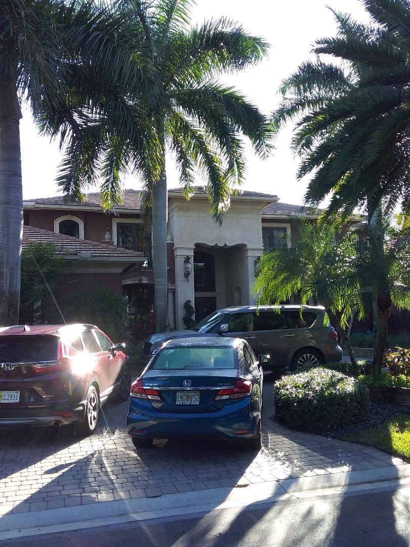 Plantation, FL - Roof tile repair in the city of Plantation Florida this repairs being done by Earl W Johnston roofing company Tony Oliver Dwayne and Justin tire repair technicians