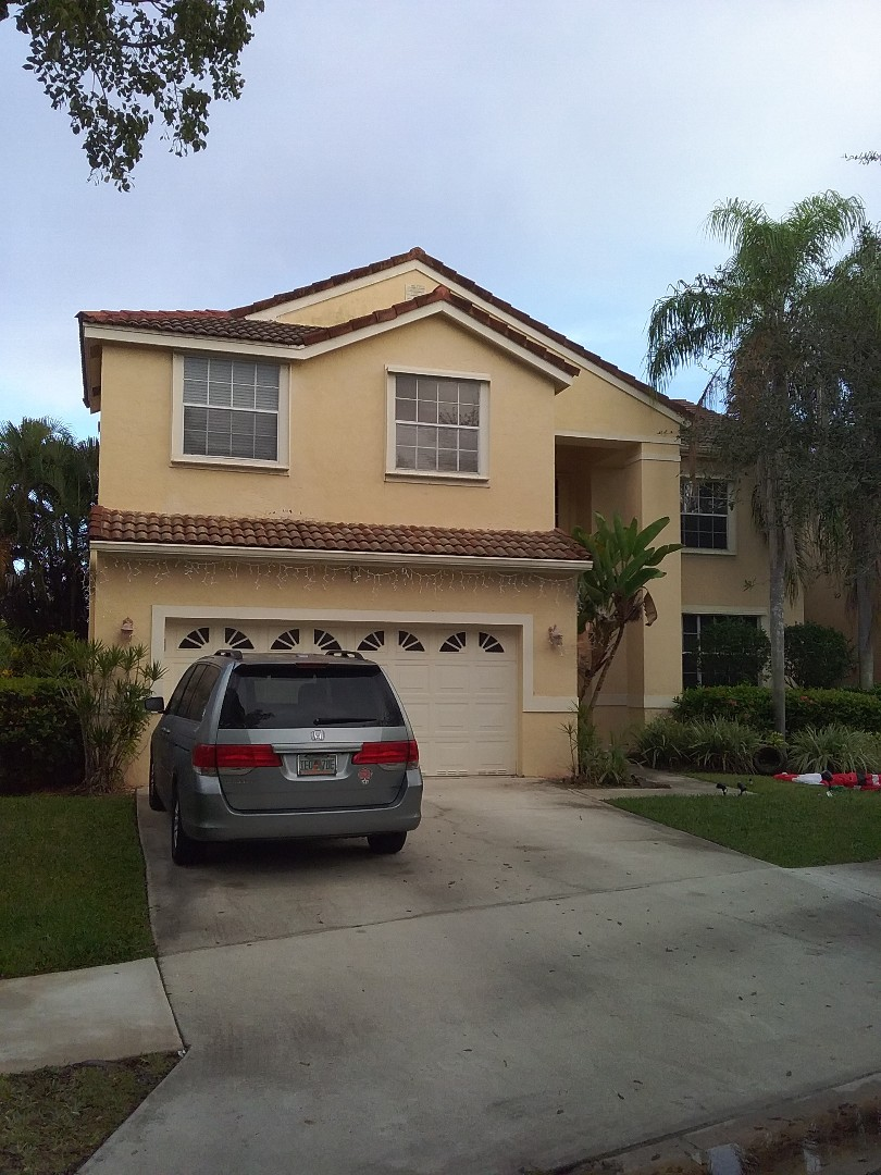 Weston, FL - Roof tile repair in the city of Weston Florida this repairs being done by Earl W Johnston roofing company Tony and Regis are your repair technicians