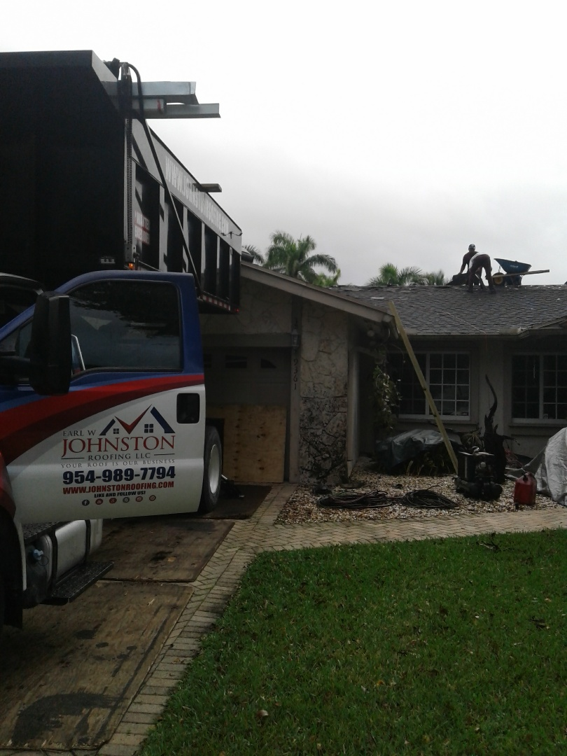 Plantation, FL - Starting a 32sq shingle reroof in plantation, by Earl w Johnston roofing.