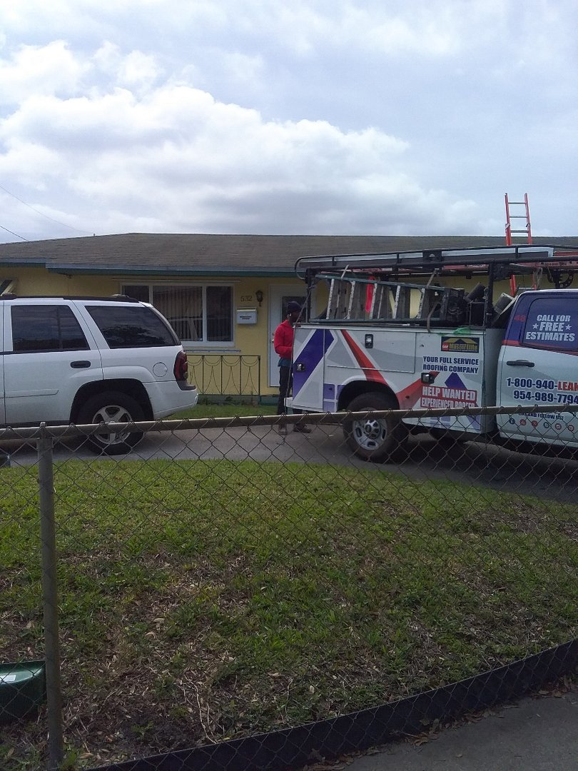Hallandale Beach, FL - Shingle roof repair in the city of Hallandale Florida this repair is being done by Earl W Johnston roofing company Tony and Darnell are you repair technicians