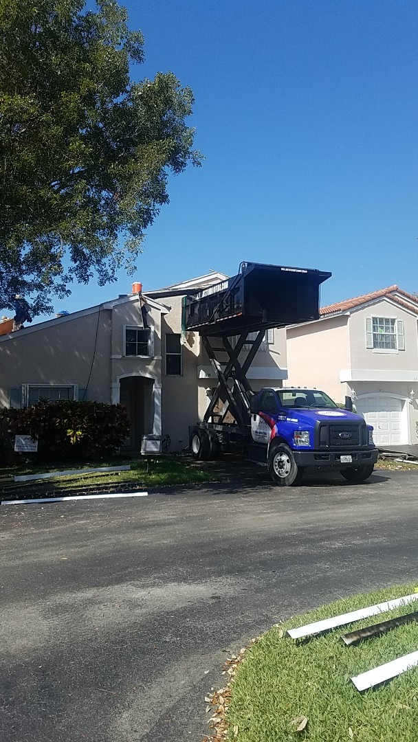 Coconut Creek, FL - Tile roof replacement tearoff by Aj from Earl Johnston Roofing Company
