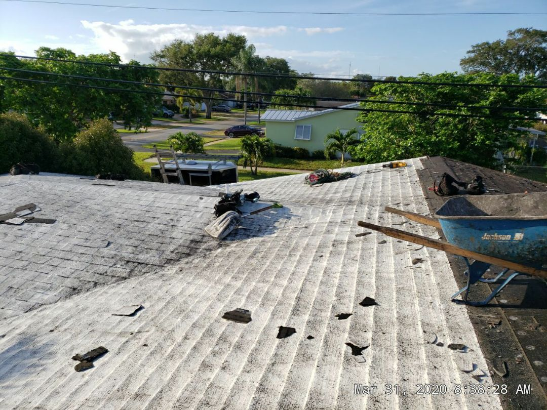 Hollywood, FL - Roof replacement is under way today in Hollywood,FL