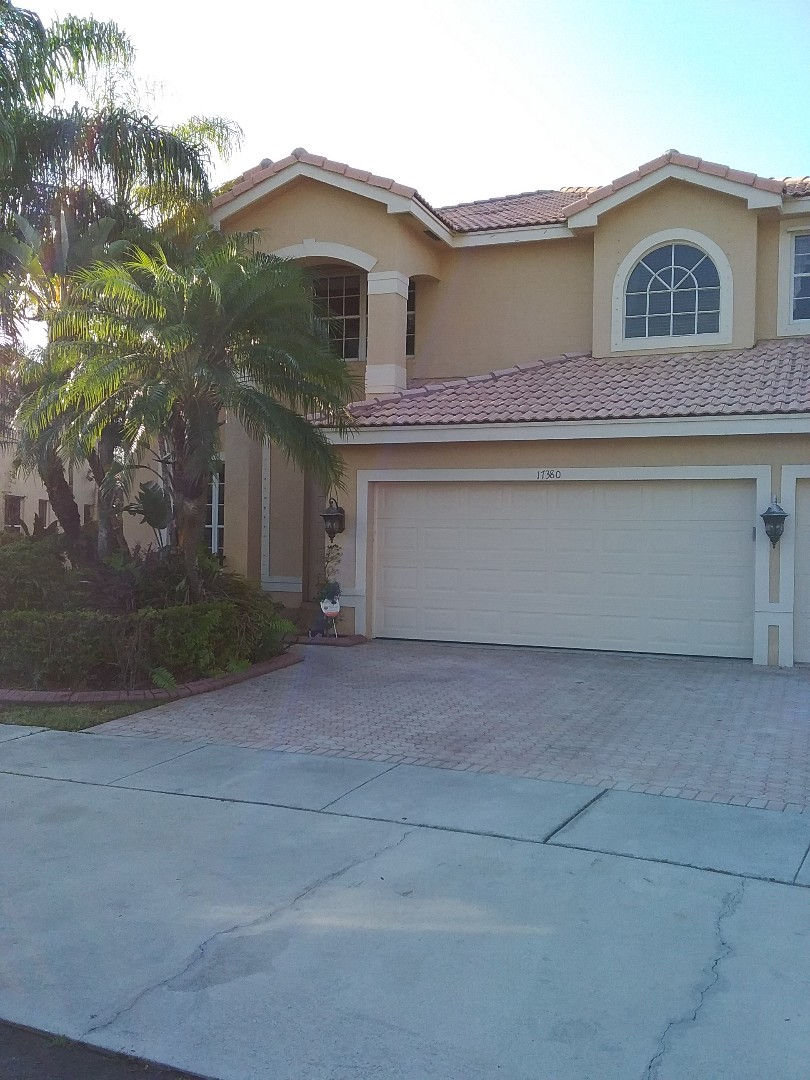 Miramar, FL - Roof tile repair in the city of Miramar Florida this repair is being done by Earl W Johnston roofing company Tony and Darnell are you repair technicians