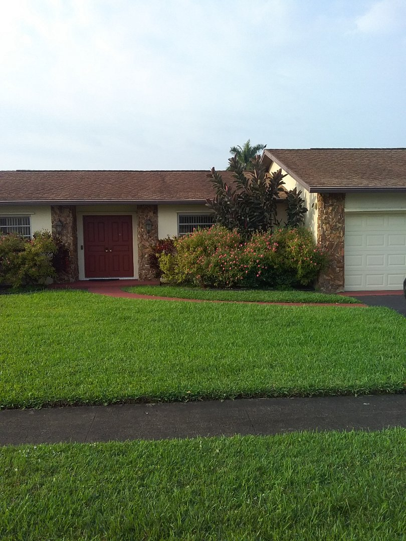 Sunrise, FL - Repair roof shingle by Oliver and Alexis from Earl W Johnston Roofing