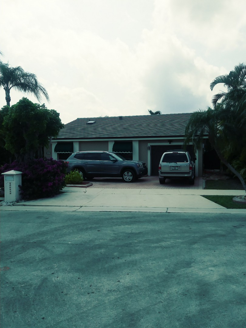 Miami, FL - Finished boral Saxony 900 slate concrete flat roof tile espresso blend color by earl w Johnston roofing llc