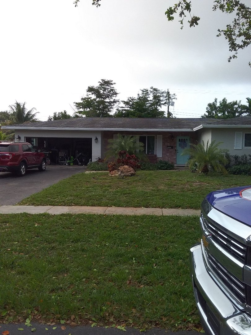 Plantation, FL - Flat deck repair and the city of Plantation Florida this repair is being done by Earl W Johnston roofing company Tony and Darnell are you repair technicians