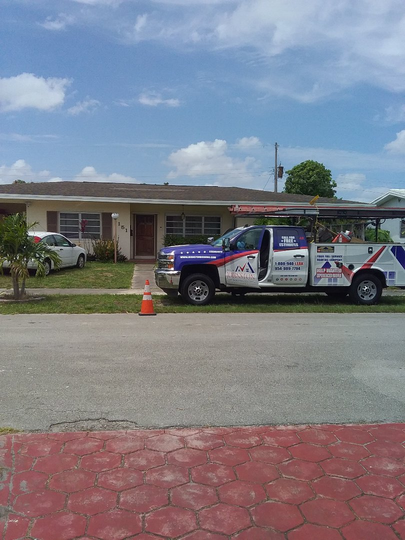 Miami, FL - Shingle roof repair in the city of Miami Florida this repairs being done by Earl W Johnston roofing company Tony and Darnell are you repair technicians picture