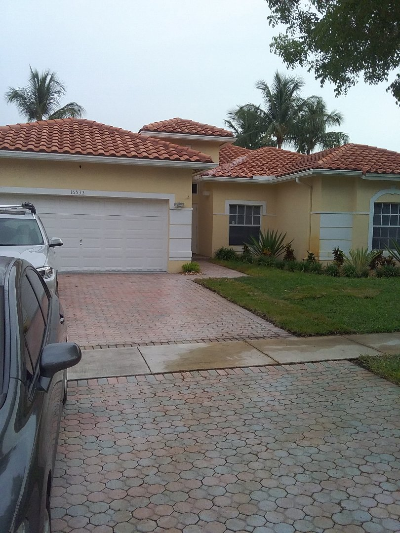 Pembroke Pines, FL - Roof tile repair in the city of Pembroke Pines Florida this repairs being done by Earl W Johnston roofing company Tony and Darnell are your repair technicians