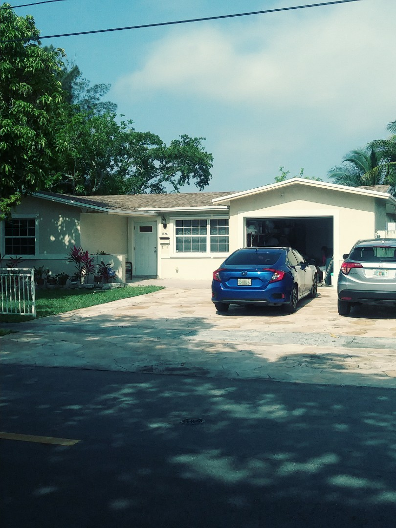 Sunrise, FL - A beautiful finished Gaf timberline shingle roof shakewood color by earl w Johnston roofing llc