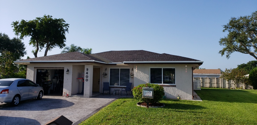 Tamarac, FL - Gaf Timberline hd shingle and flat re-roof is started in Tamarac FL by Mike Wilde of Earl Johnston Roofing