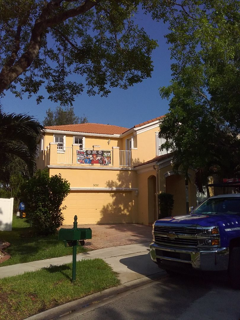Miramar, FL - Tile roof repair in the city of Miramar Florida this repair is being done by Earl W Johnston roofing company Tony and Darnell are your repair technicians