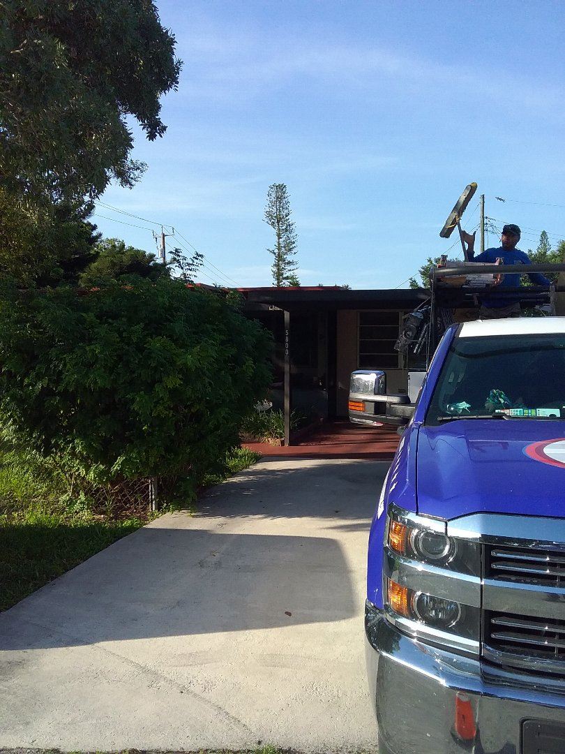 Hollywood, FL - Flat deck roof repair in the city of Hollywood Florida this repairs being done by Earl W Johnston roofing company Tony and Israel are you repair technicians