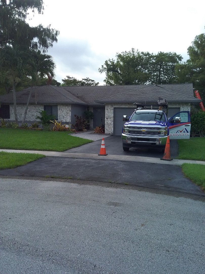 Lauderhill, FL - Shingle roof repair in the city of Lauderhill Florida this repair is being done by Earl W Johnston roofing company Tony and Darnell are you repair technicians