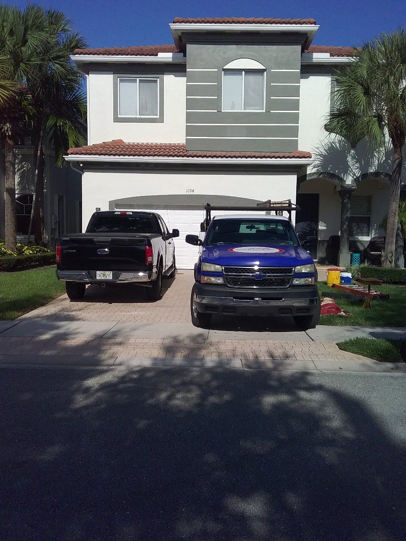 Boynton Beach, FL -  Roof tile repair in the City of Boynton Beach Florida this repair is being done by Earl W Johnston Roofing company Tony Israel Darnell and Eli are you repair technicians