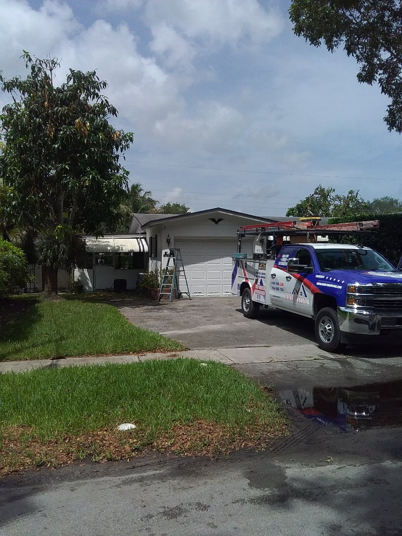 Dania Beach, FL - Facial repair being done by Earl W Johnston roofing company Tony and Darnell are you repair technicians