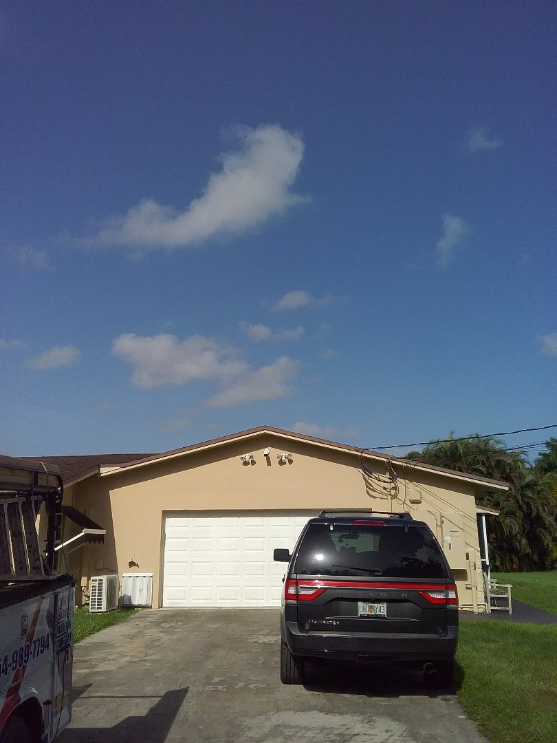 Southwest Ranches, FL - Roof repair in Southwest Ranches by Duane and Israel from Earl Johnston Roofing