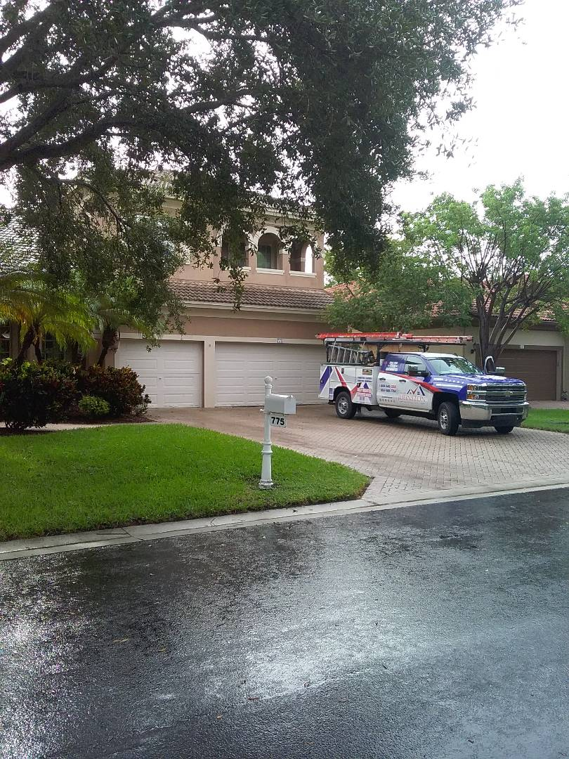 Coral Springs, FL - Roof tile repair in the City of Coral Spring Florida this repair is being done by Earl W Johnston roofing company Tony and Matthew are you a repair technicians