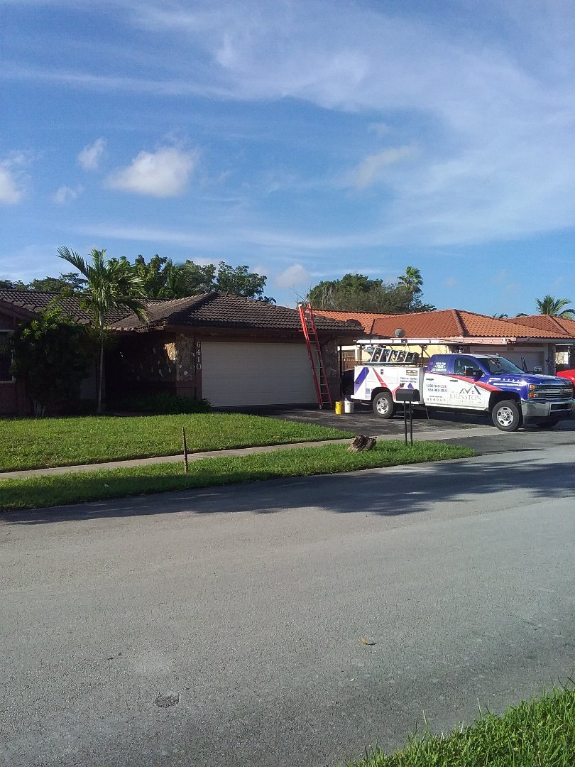 Hialeah, FL - Roof tile repair in the city of Hialeah Florida this repair has been done by Earl W Johnston roofing company Tony and Darnell are you repair technicians