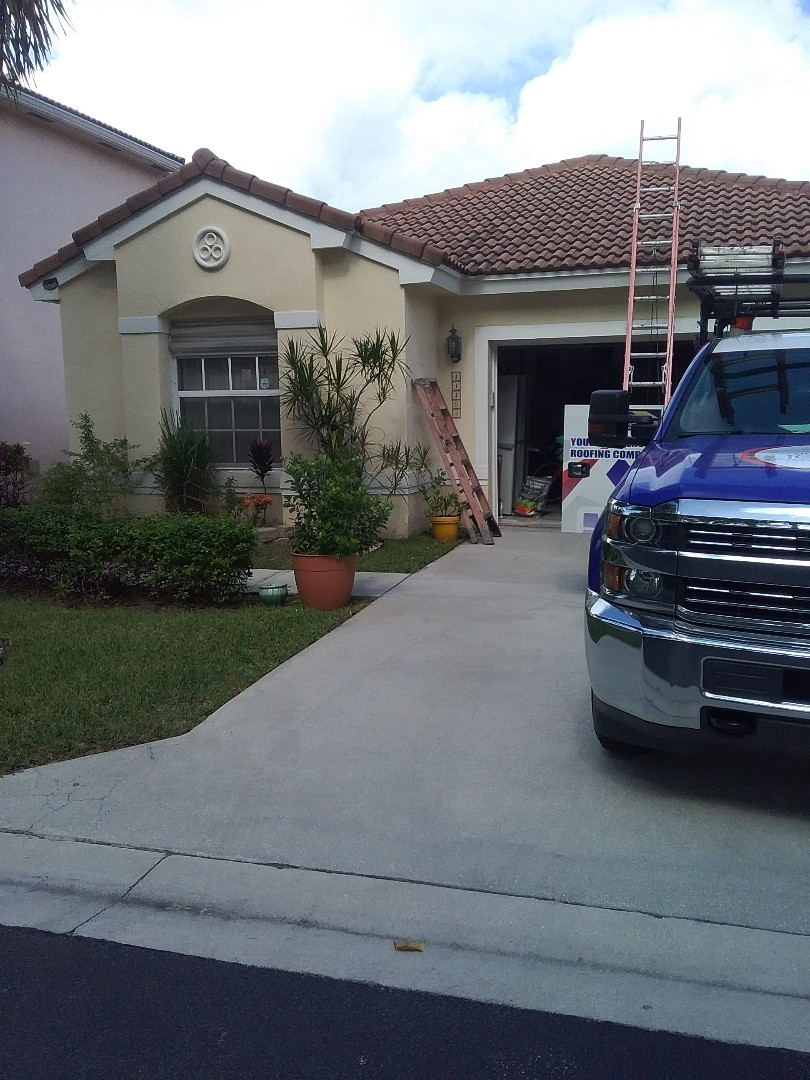 Coral Springs, FL - Roof repair in the City of Coral Springs Florida this repair is being done by Earl W Johnston roofing company Casey and Tony are you repair technicians