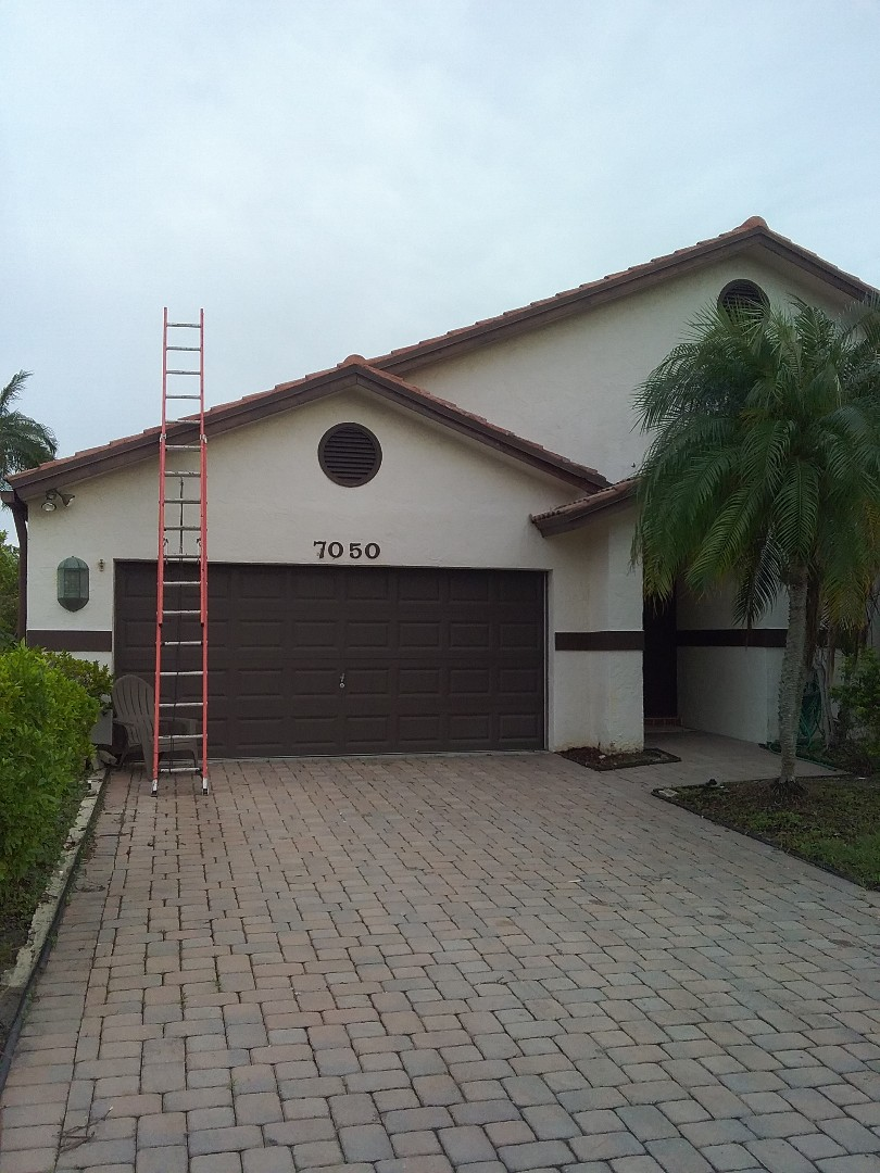 Tamarac, FL - Tile roof repair in the city of Tamarac Florida this repairs being done by Earl W Johnston roofing company Tony and Darnell are you repair technicians