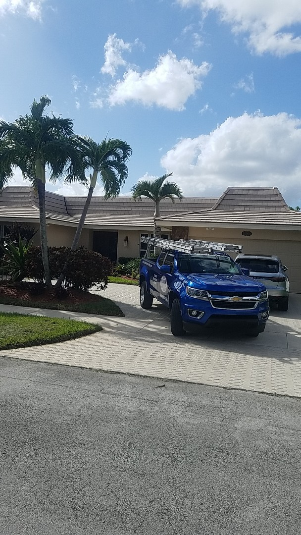North Miami Beach, FL - Boral saxony tiles with mineral cap sheet flat roof replacement estimate by Aj from Earl Johnston Roofing Company