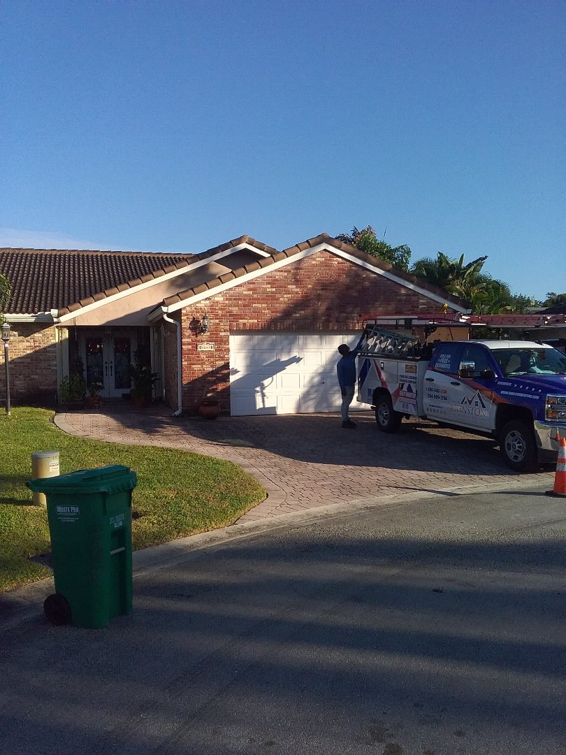 Coral Springs, FL - Roof tile repair in the City of Coral Springs Florida this repair is being done by Earl W Johnston roofing company Tony and Darnell are you repair technicians