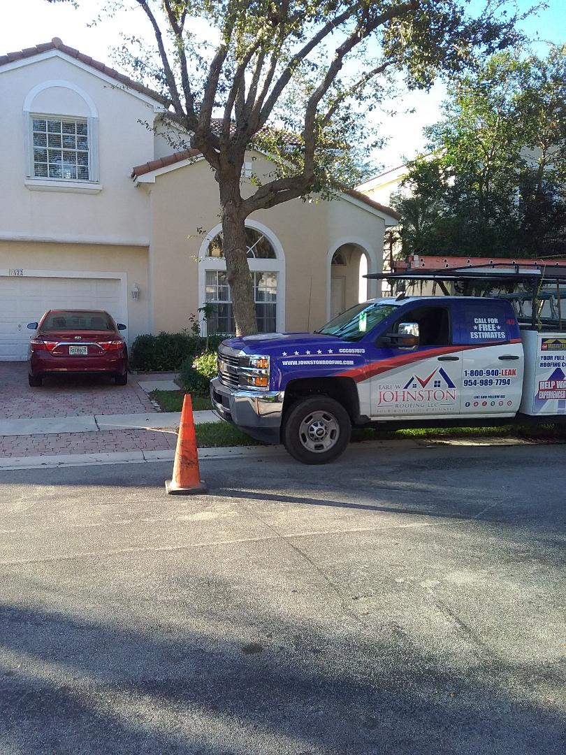 Roof tile repair in the city of Pembroke Pines Florida this repair is being done by Earl W Johnston roofing company Tony and Darnell are you repair technicians