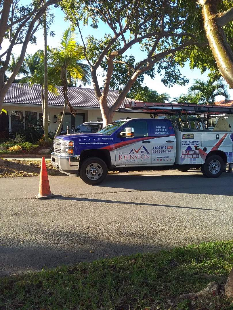 Roof tile repair in the city of Miami Florida this repair is being done by Earl W Johnston roofing company Tony and Darnell are you repair technicians
