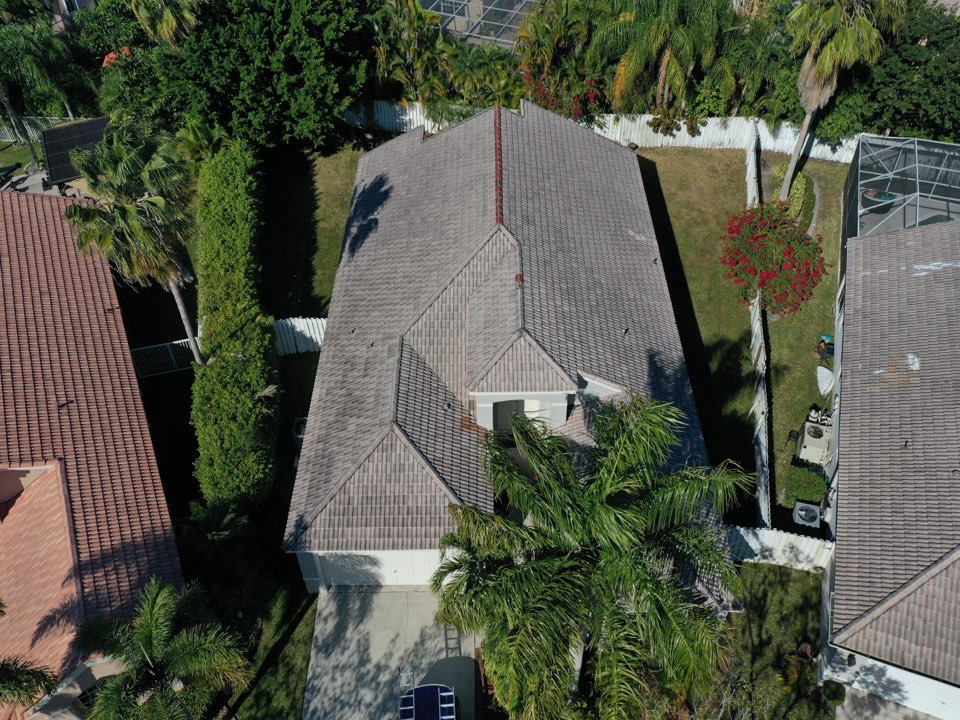 Weston, FL - Eagle Capistrano tile reroof is signed in Weston, FL by Mike Wilde of Earl Johnston Roofing