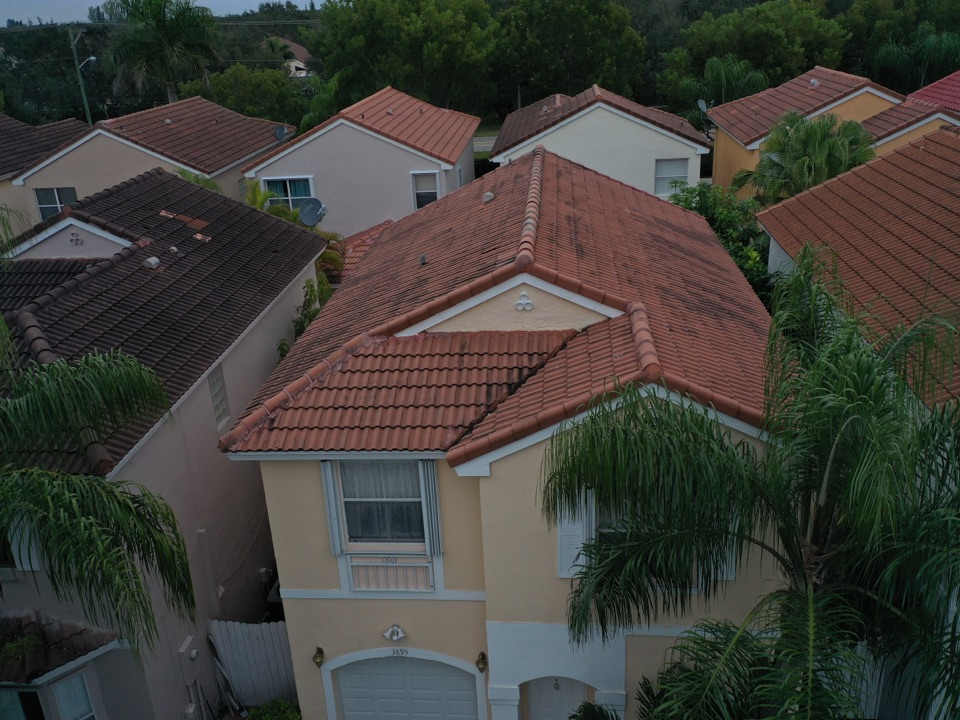 Hollywood, FL - Eagle Malibu tile reroof is signed in Cooper City,FL by Mike Wilde and Earl Johnston Roofing