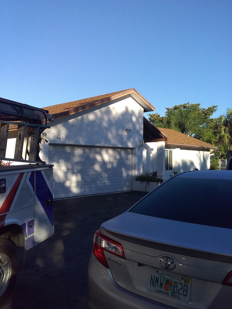 Coral Springs, FL - Shingle roof repair in the City of Coral Springs Florida this repairs being done by Earl W Johnston roofing company Tony and Darnell are you repair technicians