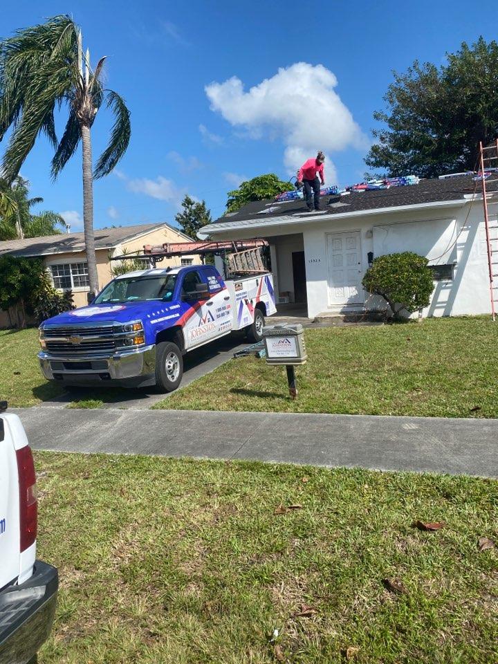North Miami Beach, FL - Roof shingle in progress in North Miami