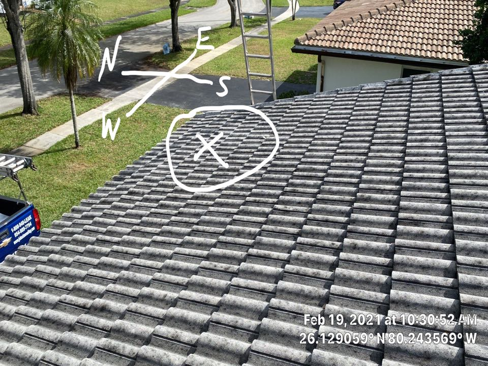 Tile roof leak repair and cleaning estimate by Mike Wilde and Earl Johnston Roofing